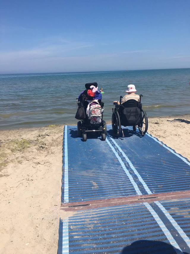 P.E.T. Consumers Liane Roberts and Sarah Hamlin on the Mobi Mat enjoying the water at Lakeside Park