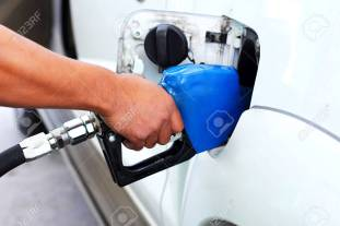 25445597-hand-fill-up-fuel-gas-station.jpg